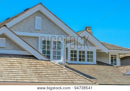The roof of the house with nice window.