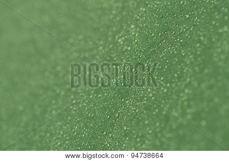 Drops of morning dew on a tourist tent. Abstract background of green fabric. Shallow depth of field