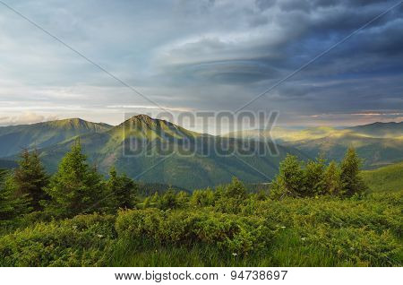 Morning in the mountains with a stormy sky. Summer landscape. Carpathian Mountains, views over the Romanian mountains