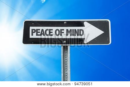 Peace of Mind direction sign with a beautiful day