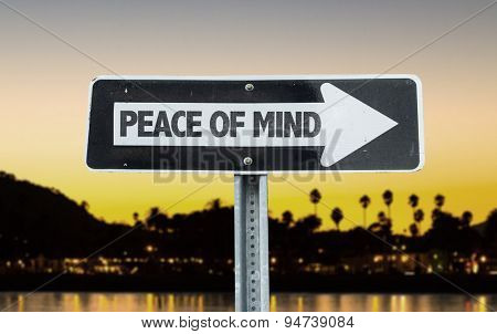 Peace of Mind direction sign with sunset background