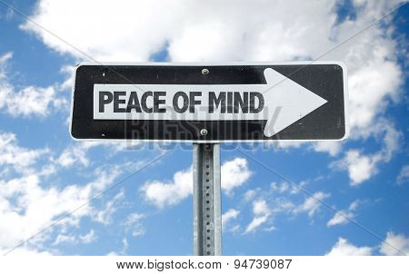 Peace of Mind direction sign with sky background