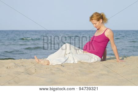 beautiful pregnant woman on a beach