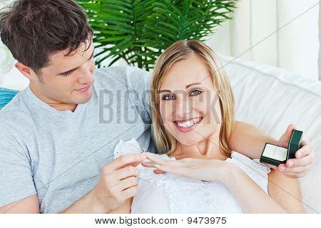 Cheerful Woman Receiving A Wedding Ring After A Proposal At Home
