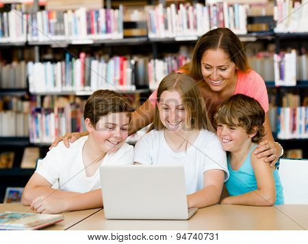 Family in library with books