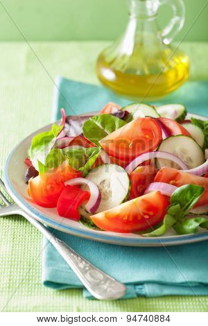 healthy tomato salad with onion cucumber pepper