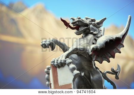LONDON, UK - JUNE 23: Detail of the City of London dragon with photograph of mountains in the background. June 23, 2015 in London.