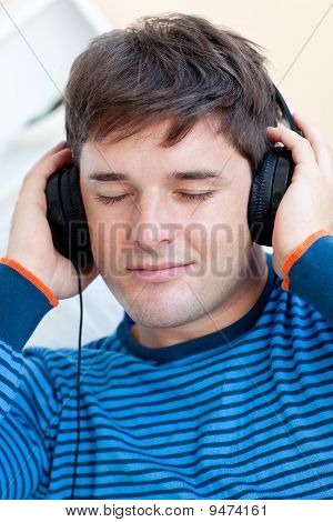 Portrait Of A Caucasian Man Listening Music Closing His Eyes
