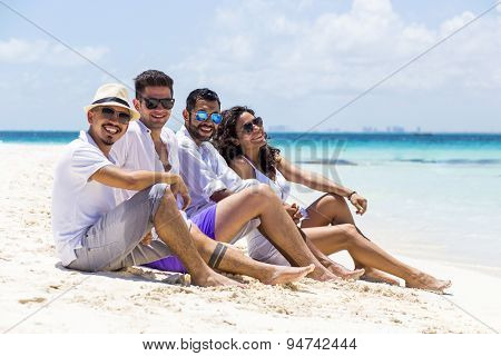 Group of friends at the beach in the Caribbean. Isla Mujeres, Cancun, Mexico.