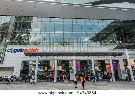 Tung Chung Wan, Hong Kong, China- June 11, 2014: people outside the CityGate Outlet shopping mall in Lantau island near the airport