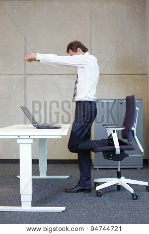 mindfulness  - young businessman taking short break for exercise in office work