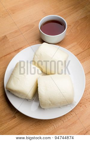 Steamed chinese bun and a cup of tea