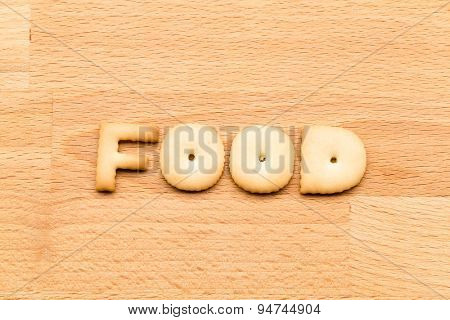 Word food cookie over the wooden background
