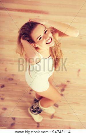 Young happy blonde woman posing