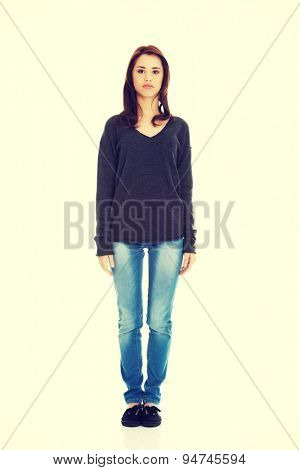 Young beautiful woman standing from the front