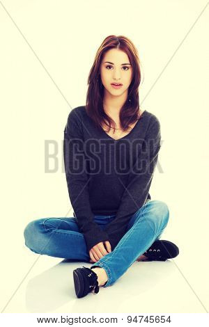 Young pretty woman sitting legged