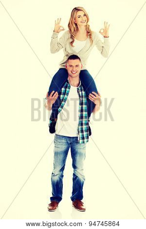Young handsome man carrying his beautiful woman