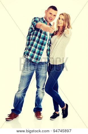 Young attractive couple showing thumbs up