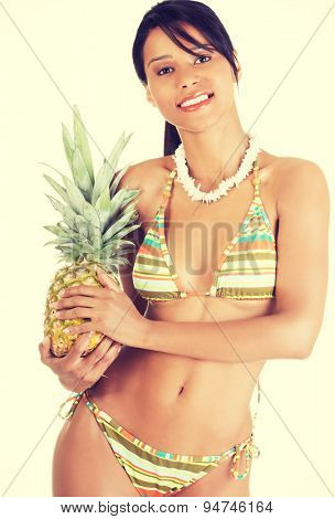 Fit and healthy woman holding pineapple in her hands