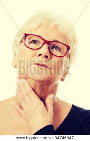 Beautiful caucasian thoughtful senior woman