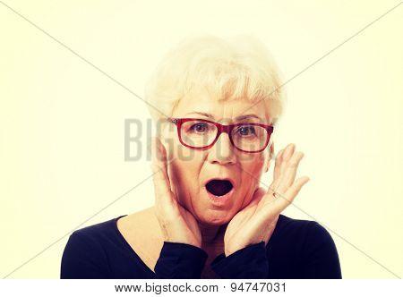 Active fit senior woman surprised