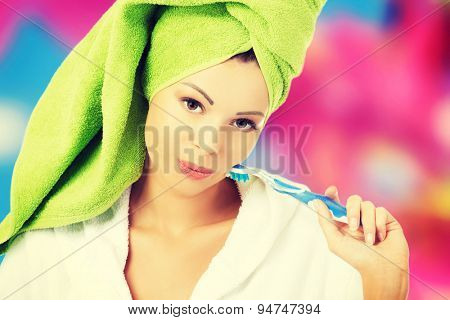 Young beautiful woman with a towel on head