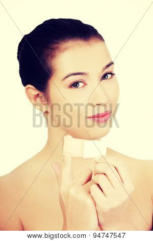 Woman applying patch on finger