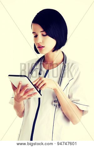 Young female doctor using a tablet