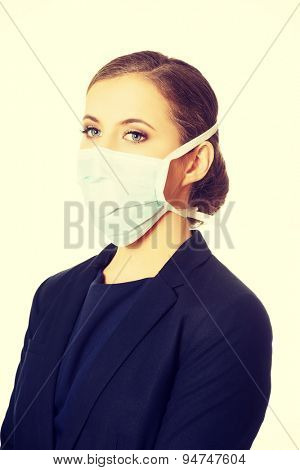 Serious businesswoman wearing doctor mask