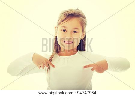 Cute little girl pointing herself