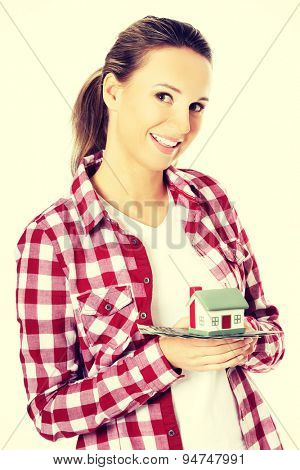 Beautiful woman holding a house model