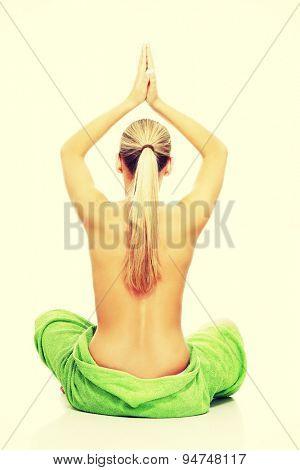 Blonde woman sitting in yoga pose