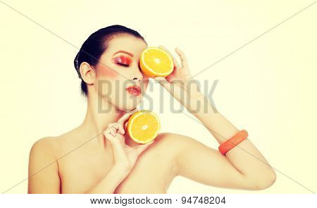 Young beautiful woman holding orange