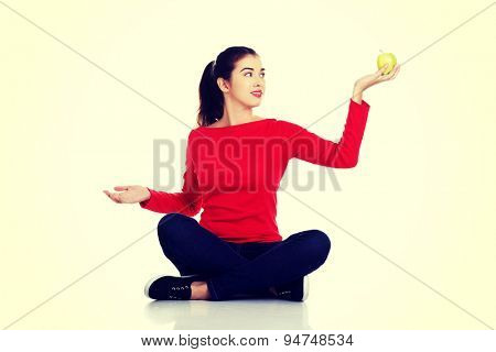 Young beautiful woman sitting cross-legged
