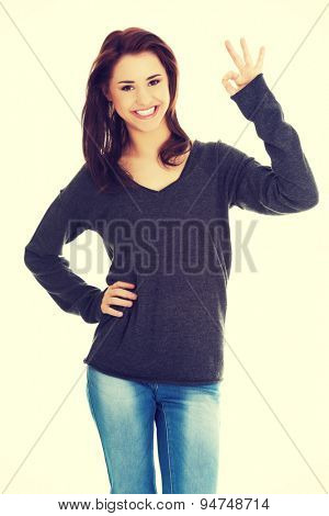 Happy smiling woman with perfect hand sign