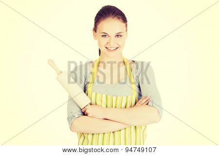 Young housewife holding rolling pin