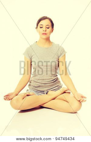 Beautiful woman relaxing by yoga