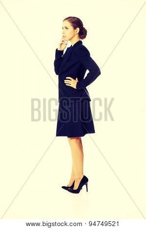 Young blonde beautiful businesswoman thinking