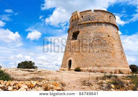 a view of the medieval tower Torre de Sa Sal Rossa in Ibiza Town, Spain