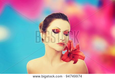 Young woman with red lilly flower