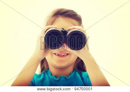 Happy little girl with binoculars