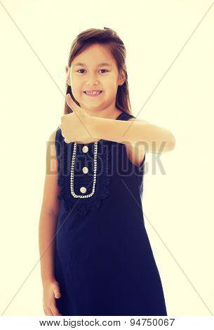 Cute little girl thumbs up