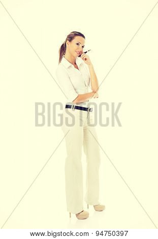 Young businesswoman thinking about an idea