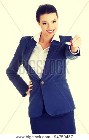 Happy woman agent holding a key