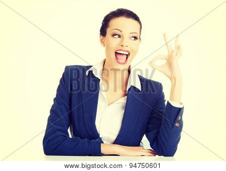 Beautiful young businesswoman gesturing ok sign