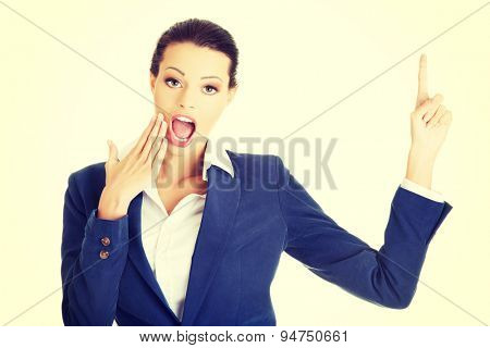 Young blonde surprised businesswoman smiling