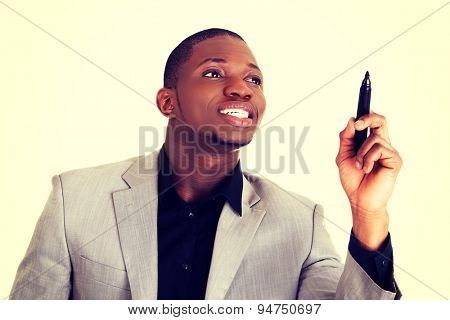 Happy black man drawing with a marker