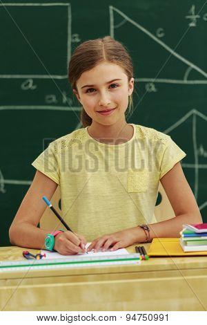 Back to school - young schoolgirl in the classroom