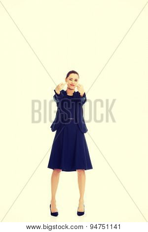 Young businesswoman gesturing by middle fingers