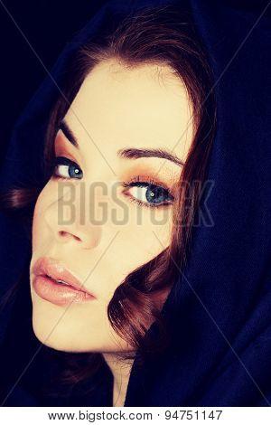 Young beautiful woman wearing headkerchief